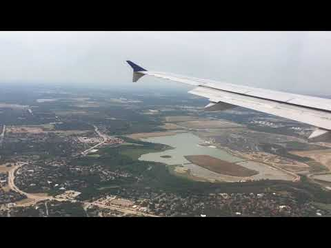 United airline, plane landing at DFW airport, TX, arriving gate, with amazing window view