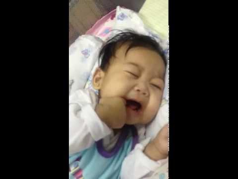 baby girl crying while sleeping (teething)