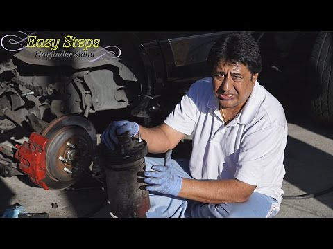 Remove Leaking Air Suspension on 07-14 Lincoln Navigator - Part 1
