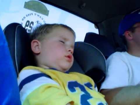 Kid falling asleep riding in the car