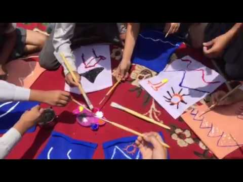 Nepal children making prayer flags for rivers and peace