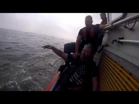 Coast Guard Boat and Aircrews Rescue People from Capsized Boats