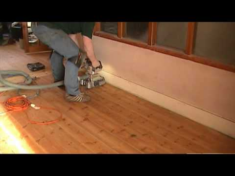 sanding and oiling a wooden pine floor dust free