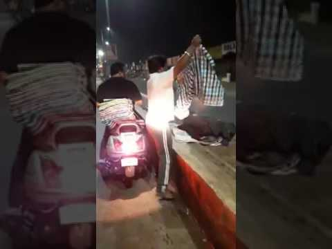 Man distributing blankets to poor and needy people road side