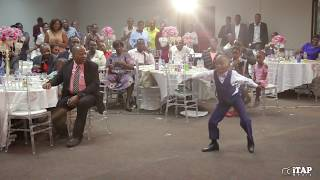 Young boy dances to Baba Harare's