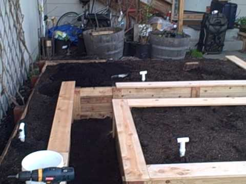 Newest Raised Bed Almost Completed - Putting on the top trim
