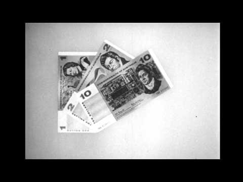 Film shows the new banknotes explains the equivalence of $1 to shillings