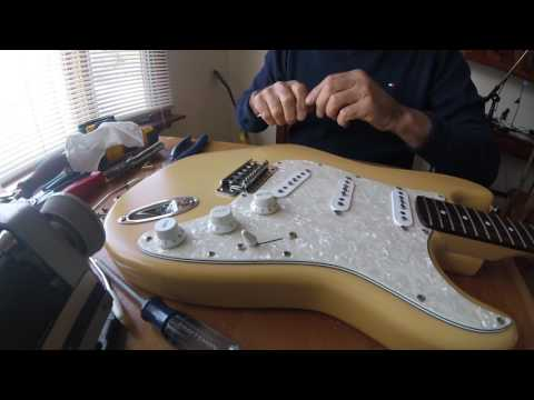 How to change a Stratocaster Guitar Bridge.
