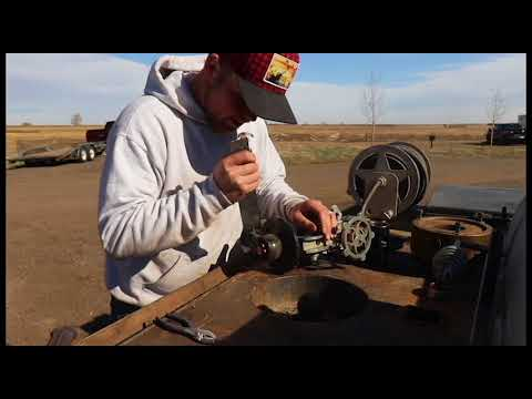 Rebuilding a rollout wheel/ positioner. Schofield Welding