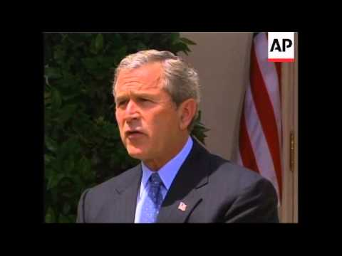 Bush meets Canadian PM, comments on Iraq