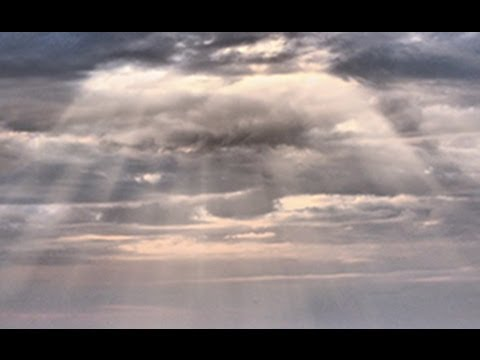 Photoshop Tutorial: How to make realistic SUNBEAMS shine through clouds.