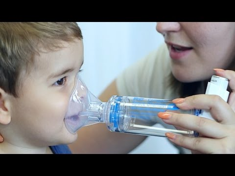 Inhalation with a metered dose inhaler (puffer) via a spacer and facemask