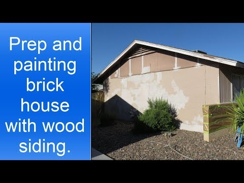 Painting a brick house with wood siding.