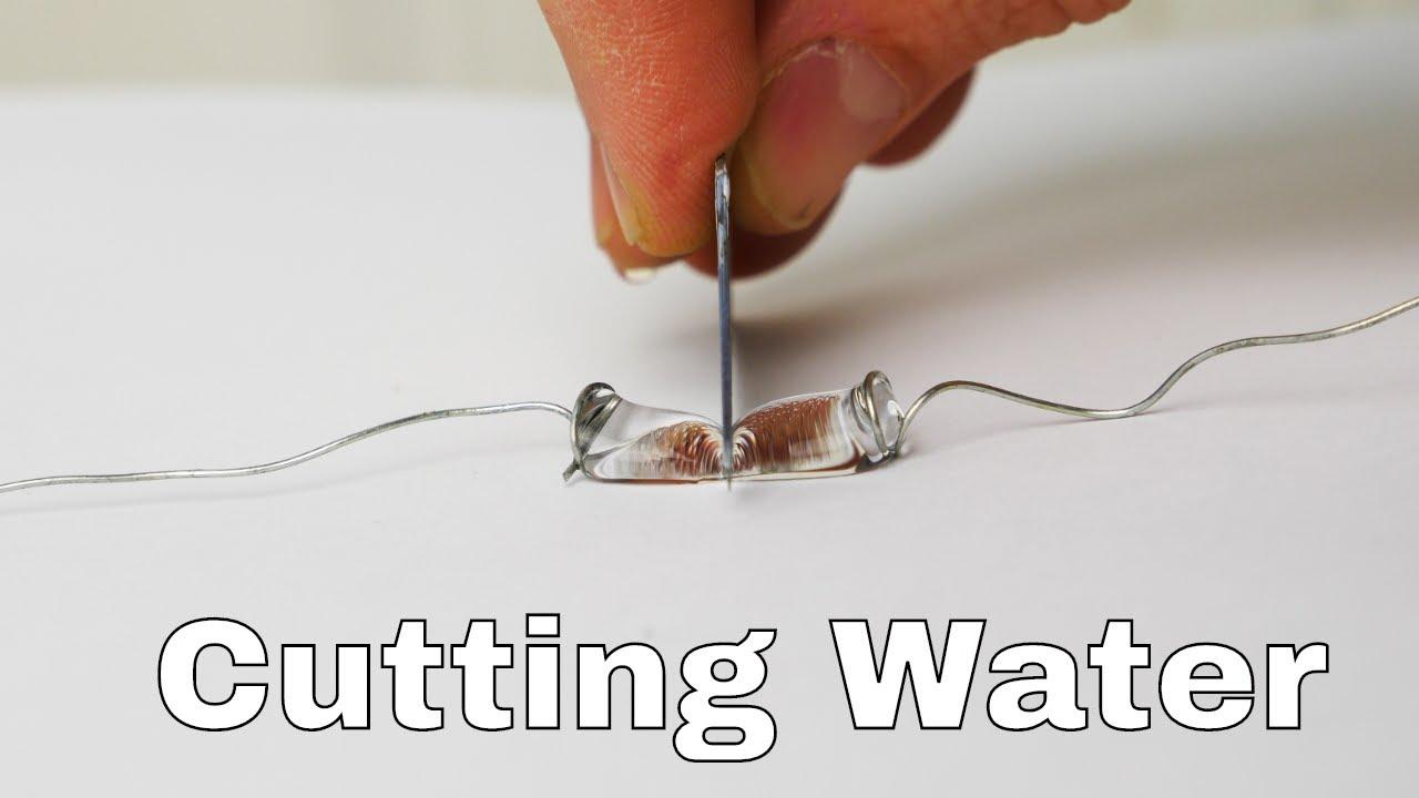 Superhydrophobic Knife Slices Water Drops in Half