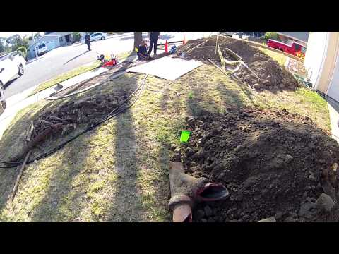 Trenchless sewer installation under driveway.