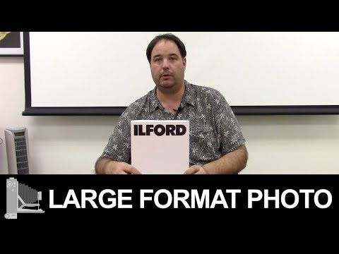 How to load and unload large format film