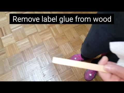 Remove sticker label glue from wood