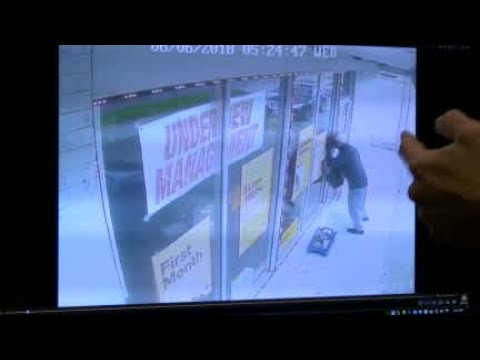 Surveillance video from Boost Mobile robbery