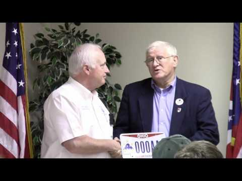 Terry Johnson accepts honorary Ohio Military Sacrifice License Plate