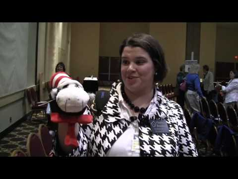 Music teacher having fun with Cat in the Hat puppet