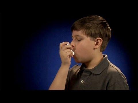 Using a metered dose inhaler (inhaler in mouth)