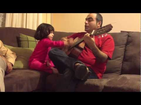 very cute persian girl is singing a famous song (gole yakh) with me.