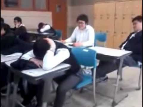 Kid get slapped while sleeping in class.