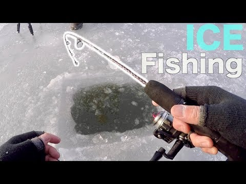 BIG FISH THROUGH THE ICE!!! Ice Fishing a TIDAL River (CRAZINESS)