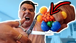 Download CUTTING OPEN GIANT STRESS BALLS!! (WHAT'S INSIDE) Video