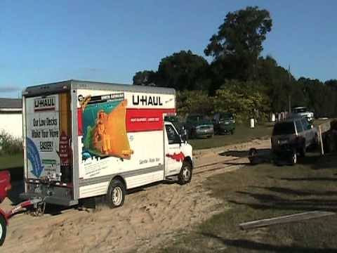 U HAUL TRUCK STUCK IN SAND. PULLED OUT WITH A SUV