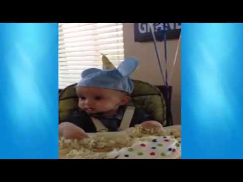 Funny baby eating his first birthday cake