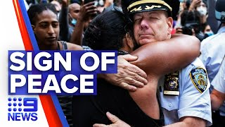Protesters and police officers join in solidarity | Nine News Australia