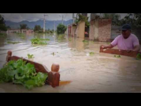 Massive FLOODS ravage BOLIVIA S America 30 DEAD 21,000 Homeless 1.29.14