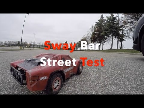 Traxxas Slash 4x4 Sway Bar Test - on 3S LiPo, slightly wet ground and trying to spin out