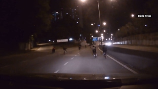 Dashboard camera shows cyclists endangering themselves
