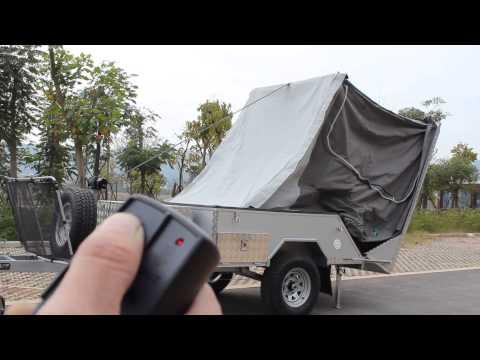 Automatic set up hard floor camper trailer