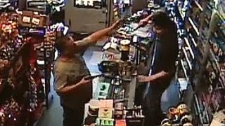 Armed robber meets his match - CCTV