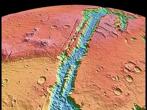 Remote sensing survey of Valles Marineris: insights into magmatic and sedimentary processes on Mars