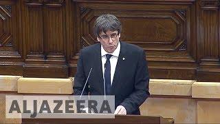 Catalonia president suspends independence, seeks talks with Madrid