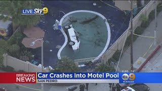 At Least 1 Critical After Car Slams Into Motel Pool