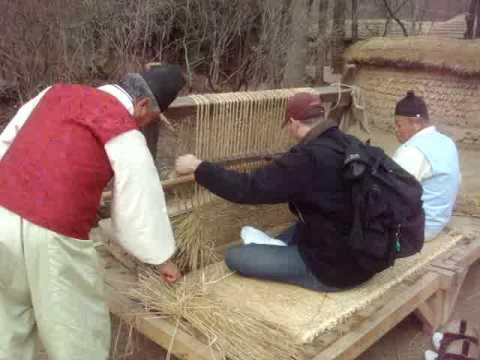 Brandon weaving rice straw.MPG