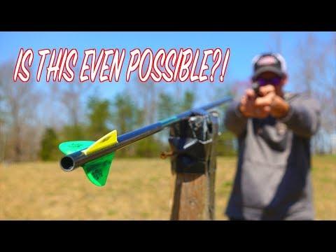 SHOOTING A BULLET THROUGH AN ARROW SHAFT - SLOW MOTION TRICK SHOT