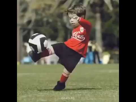 Small Boy's playing football like crazy