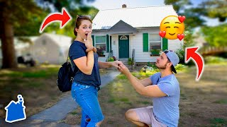 HE PROPOSED IN FRONT OF OUR FIRST HOME!