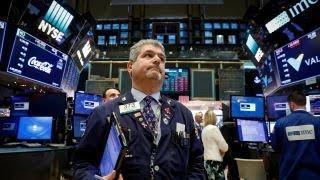 Markets close lower amid tax reform battle, net neutrality vote