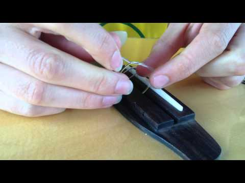 How to Replace Strings on an Acoustic/Classical Guitar (Nylon strings)