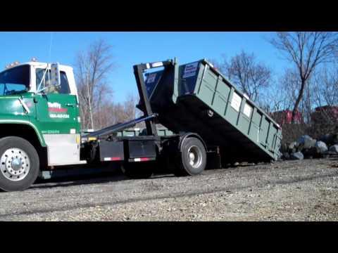 Hooklift truck loading an Dumpster - Hook Lift