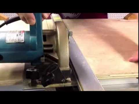 Shopsmith:Cutting Plywood on a Mark 7 as sawhorse/clamping/cutting bench.
