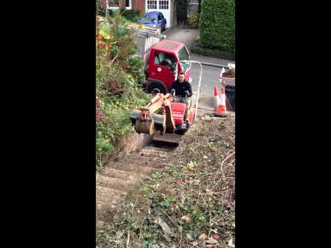 Mini digger up stairs