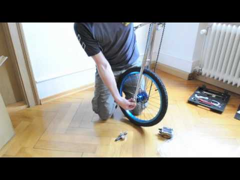 assembling a QU-AX Giraffe, high unicycle